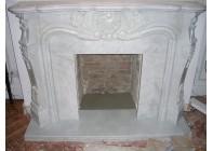 Резной каминный портал из мрамора Bianco Carrara